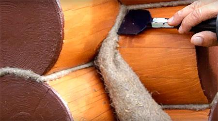 Конопатка сруба по углам